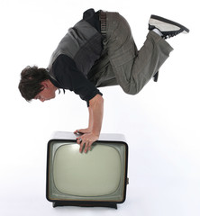 Man hold balance on retro TV set. Television and mass media
