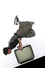 Man hold balance on retro TV set. Television and media concept
