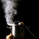 big pan and smoke on black