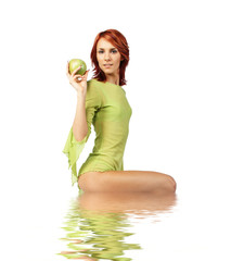 cute girl with fresh green apple in the water