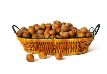 Wood nuts in a basket isolated on a white background