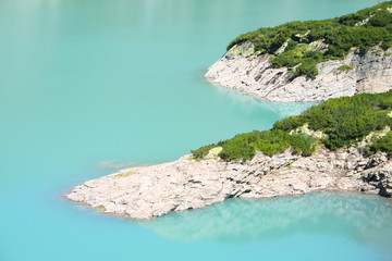 A beautiful alpine lake with resort and vegetation