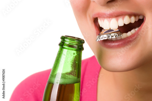 Smiling young woman with bottle of beer - 9087626