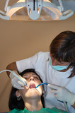 consulting a dentist during a dental cleaning poster