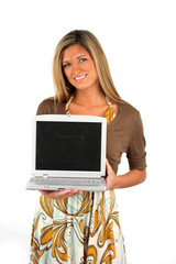 Happy young woman holding a computer for advertisement