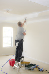 Contract painter updating colors of walls and painting ceilings