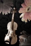 old wooden violins on black and flowers in sepia