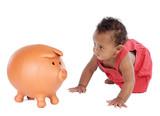 African beautiful baby crawling towards a piggy bank poster