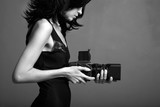 Fashion portrait of young photographing lady