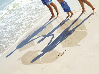 Family and recycling symbol in sand