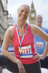 Female runner with gold medal
