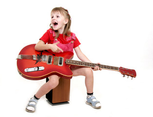 little girl with red guitar