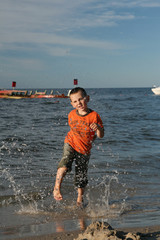 Child, water and fun. Beach fun.