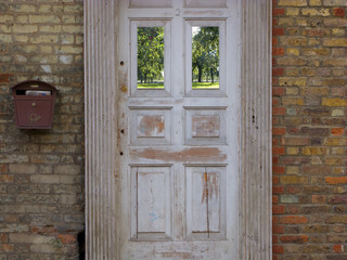 Old-fashioned door and brick house