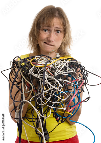 crazy woman with tangle of cables and wires in hands