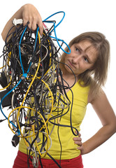 pensive woman with tangle of cables and wires in hands
