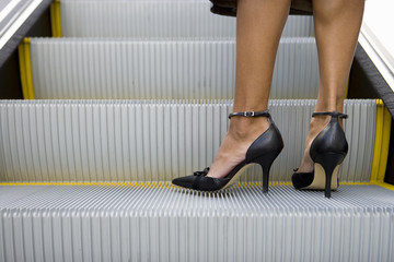 Womans feet on escalator
