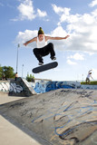 Skateboarder Doing flip on ramp