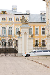 Wedding car waiting in front of palace