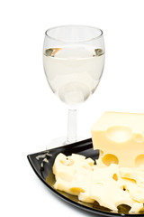 Wine in a glass  and cheese on a white background