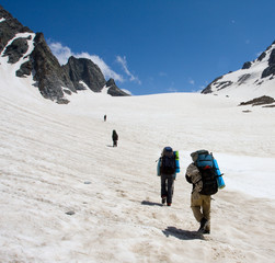 Group of mountain-climber going up to snow pass