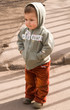 Toddler buried his hands in his pockets