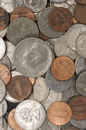 A macro studio shot of a pile of dirty coins.