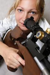 The sad girl with a gun in studio