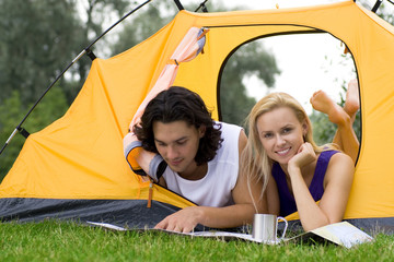 Couple Reading Map in Tent