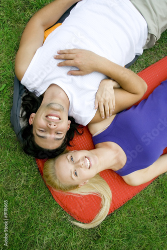 Couple lying on sleeping bags
