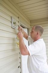 Electrician installing new light fixture