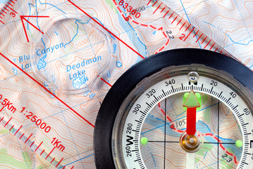 Transparent Navigational Compass on Topographical Map