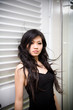 asian young women wind blowing her long black hair
