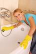 Woman washes a bath