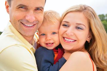 smiling family. faces closeup