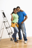 Portrait of couple with ladder.