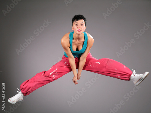 dancing woman in sportswear  jumps