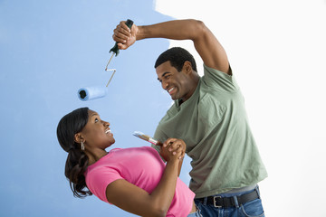 Man being playful with woman.