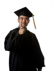 Model in graduation robes pointing his index finger