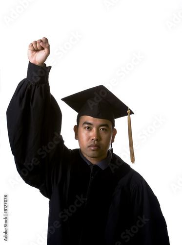 Model in graduation robes and regalia with fist raised