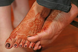 Mehndi artists decorated  feet