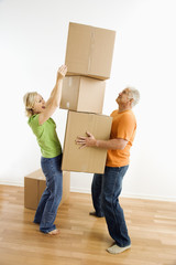 Woman stacking boxes.