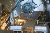 White hot sparks at grinding steel material.. poster