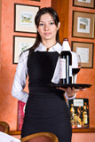 The girl the waiter with a tray on which bottle red wine poster