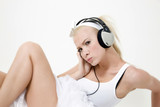 sexy blond woman listening to music