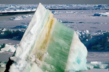Ice floe with colorful layers