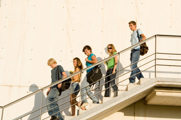 school or college students walking down stairs