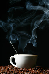 coffee beans and white hot cup of drink