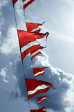 Red-white triangular ship flags poster