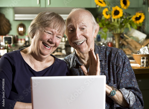 Smiling Senior Couple with a Laptop Computer